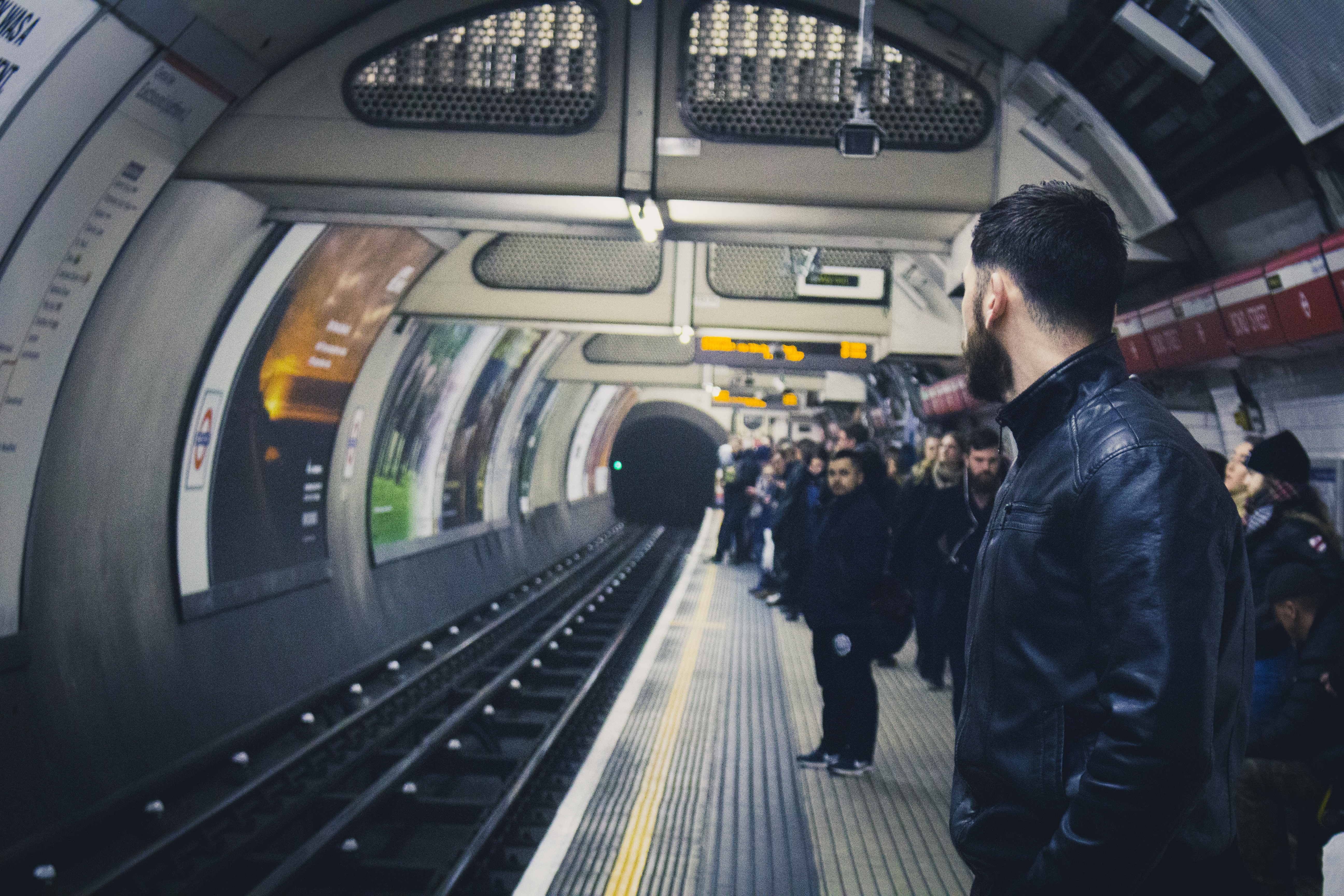 People waiting for a train in the London Underground