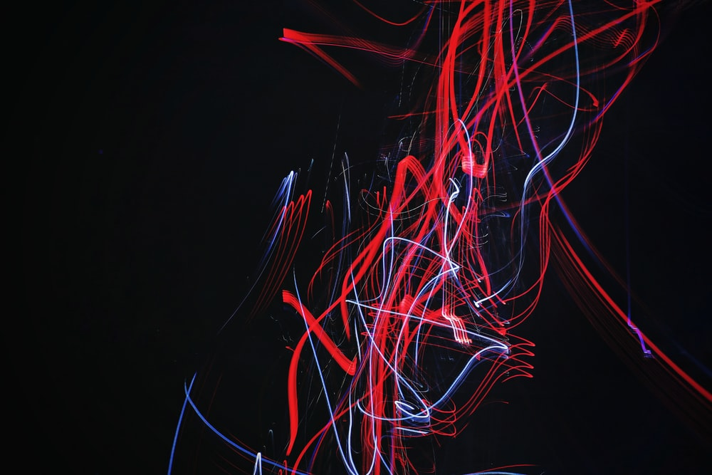 red and blue doodle artwork with black background