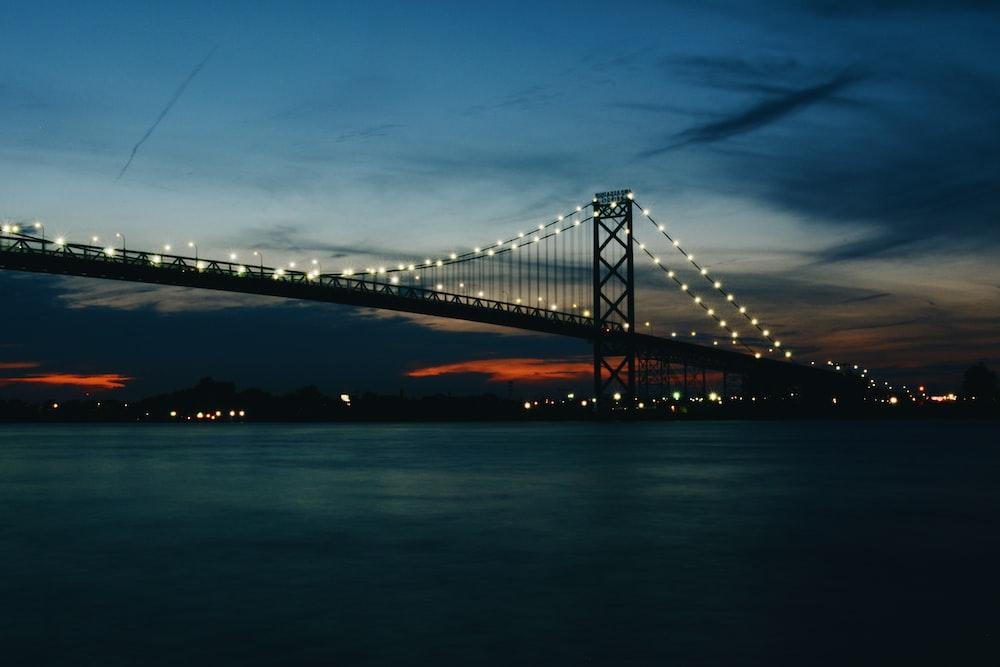 gray steel bridge during night time