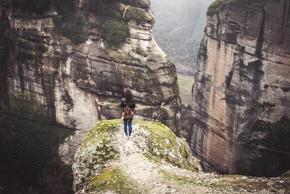 woman standing near cliff