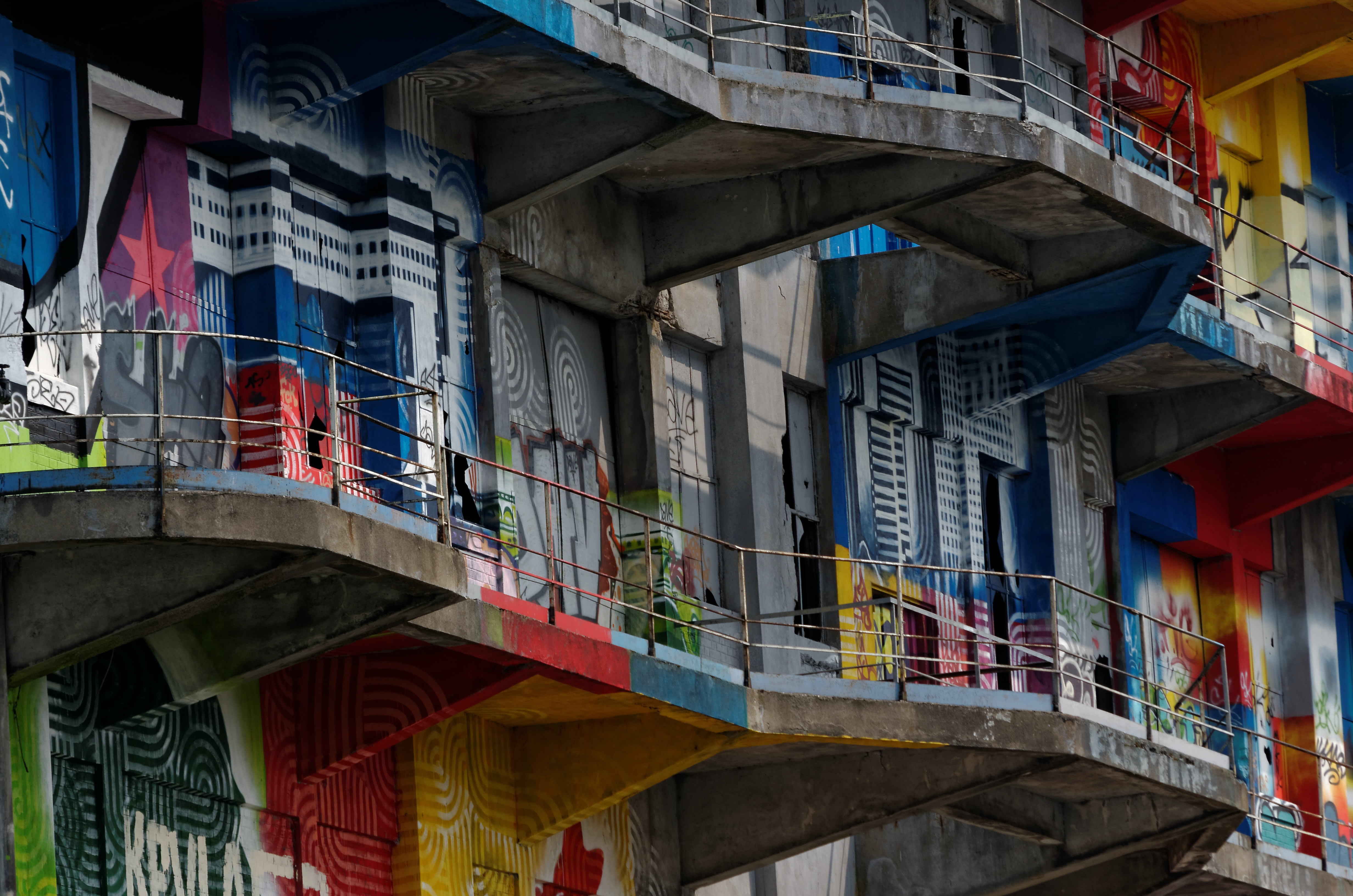 Urban residential apartment buildings in Pantin with colorful street graffiti street art on walls