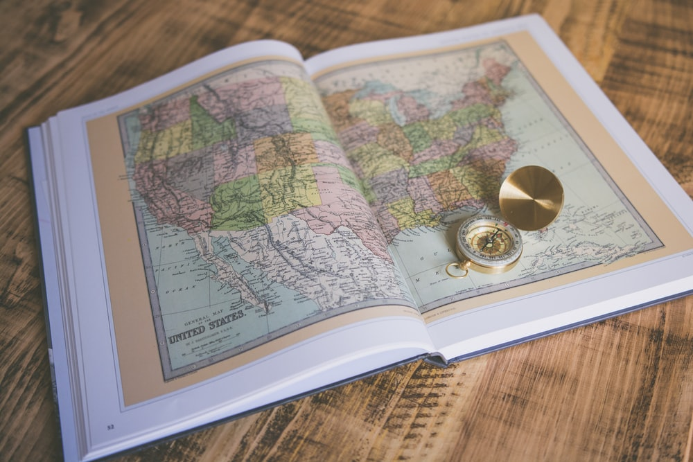 compass on map book page