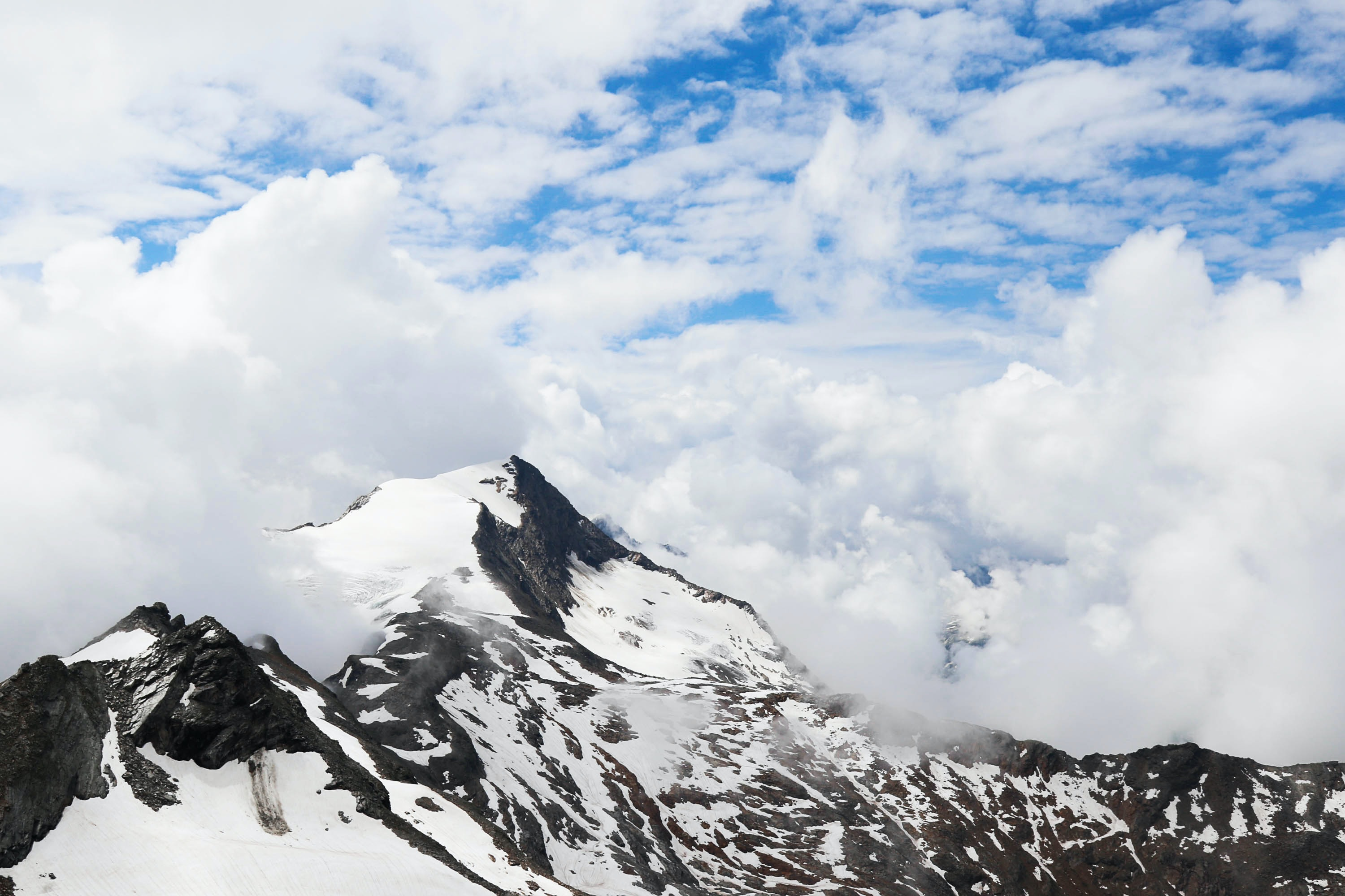 The snow-capped Kitzsteinhorn mountain enveloped in dense clouds