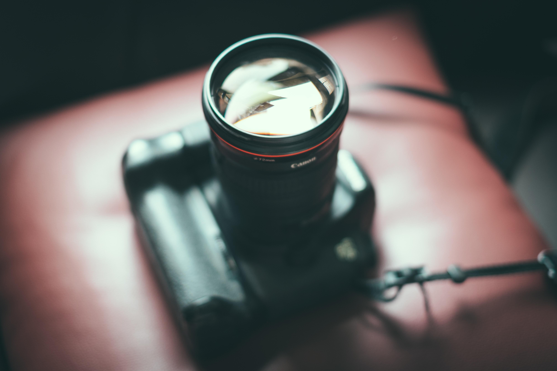 A DSLR camera with lens facing upwards.