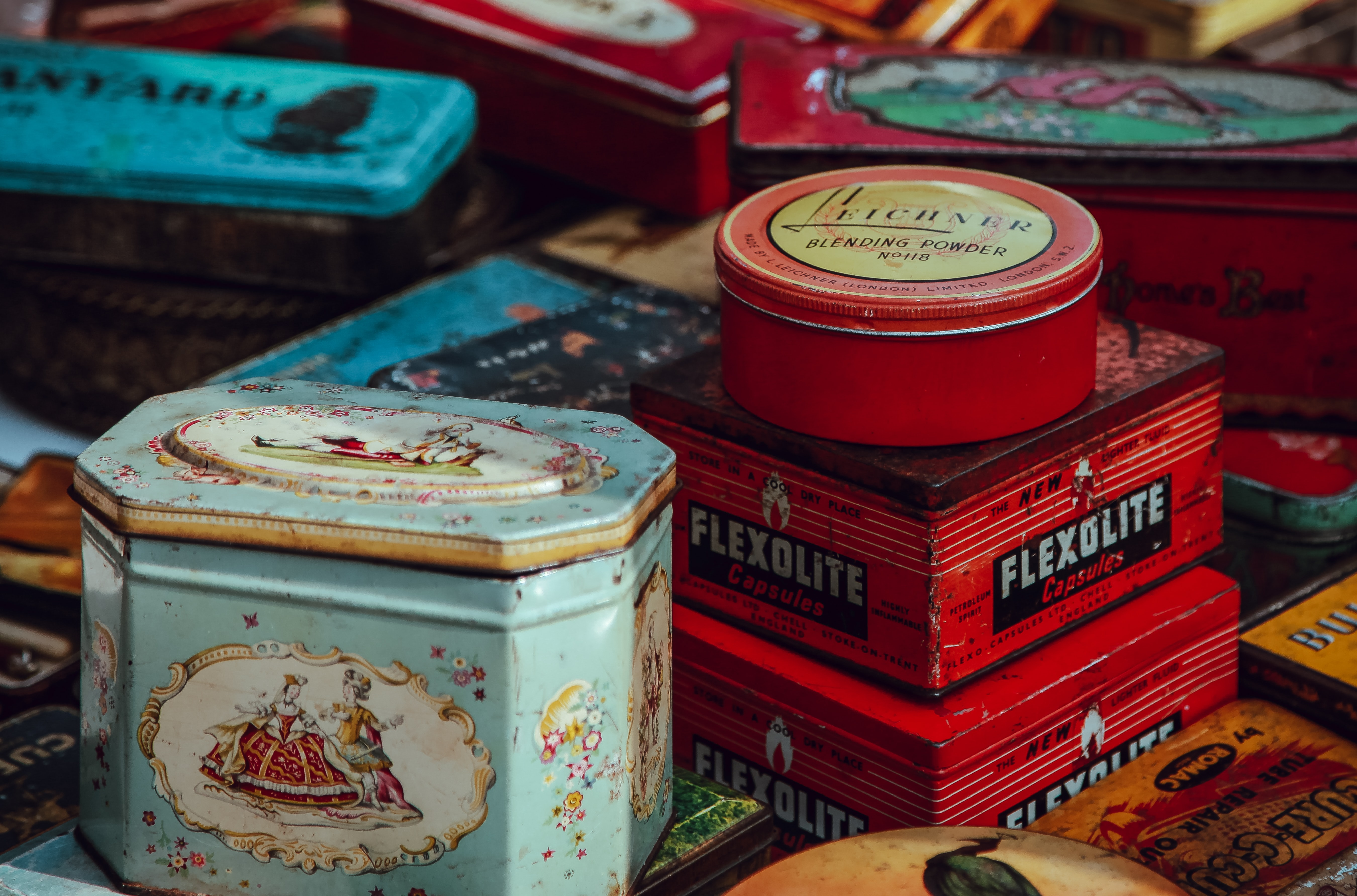 Old stuff packaged in tin and boxes stacked together in a flea market at lewis cubits square.