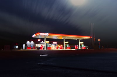 circle gas station along the road during night time illuminated zoom background