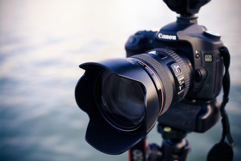 shallow focus photography of black Canon DSLR camera