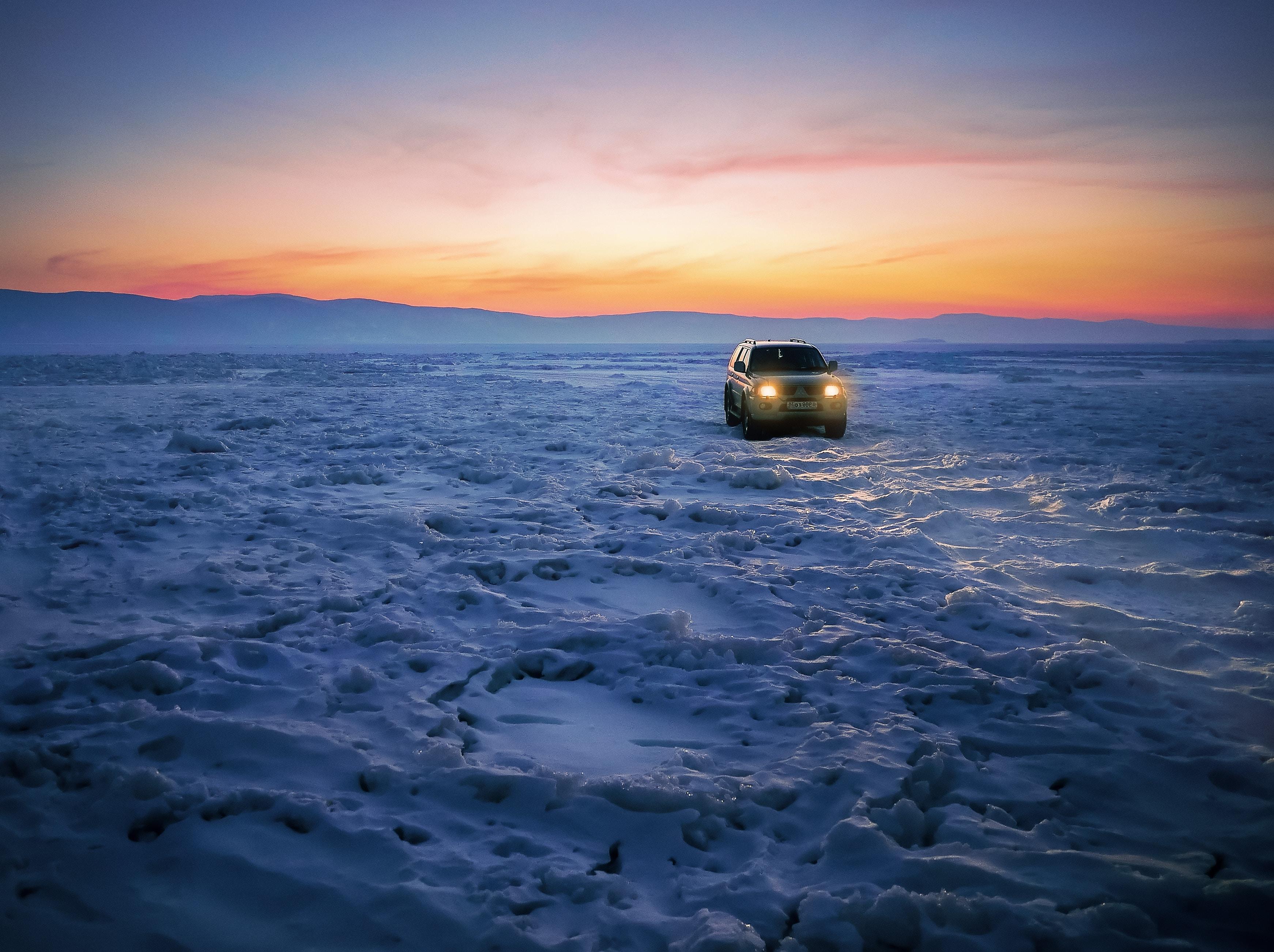 car on snow pavement