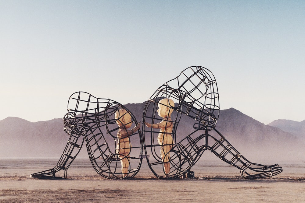 Burning Man wire sculpture with baby dolls in Black Rock Desert