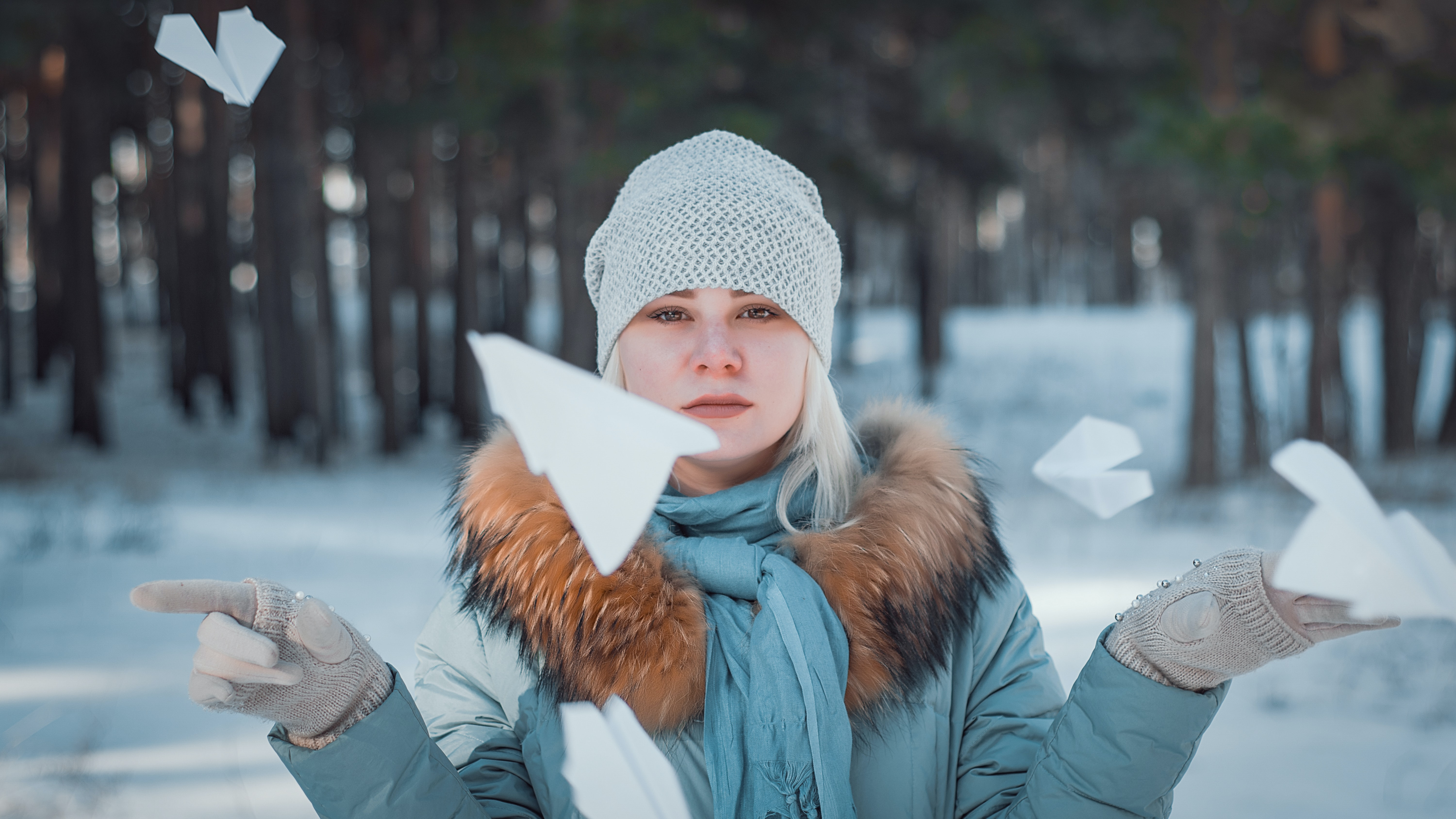 woman surrounded by flying paper plane