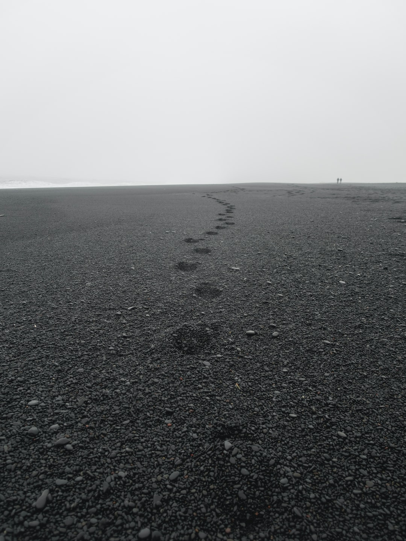 Footprints on Reynisfjara beach, Iceland.