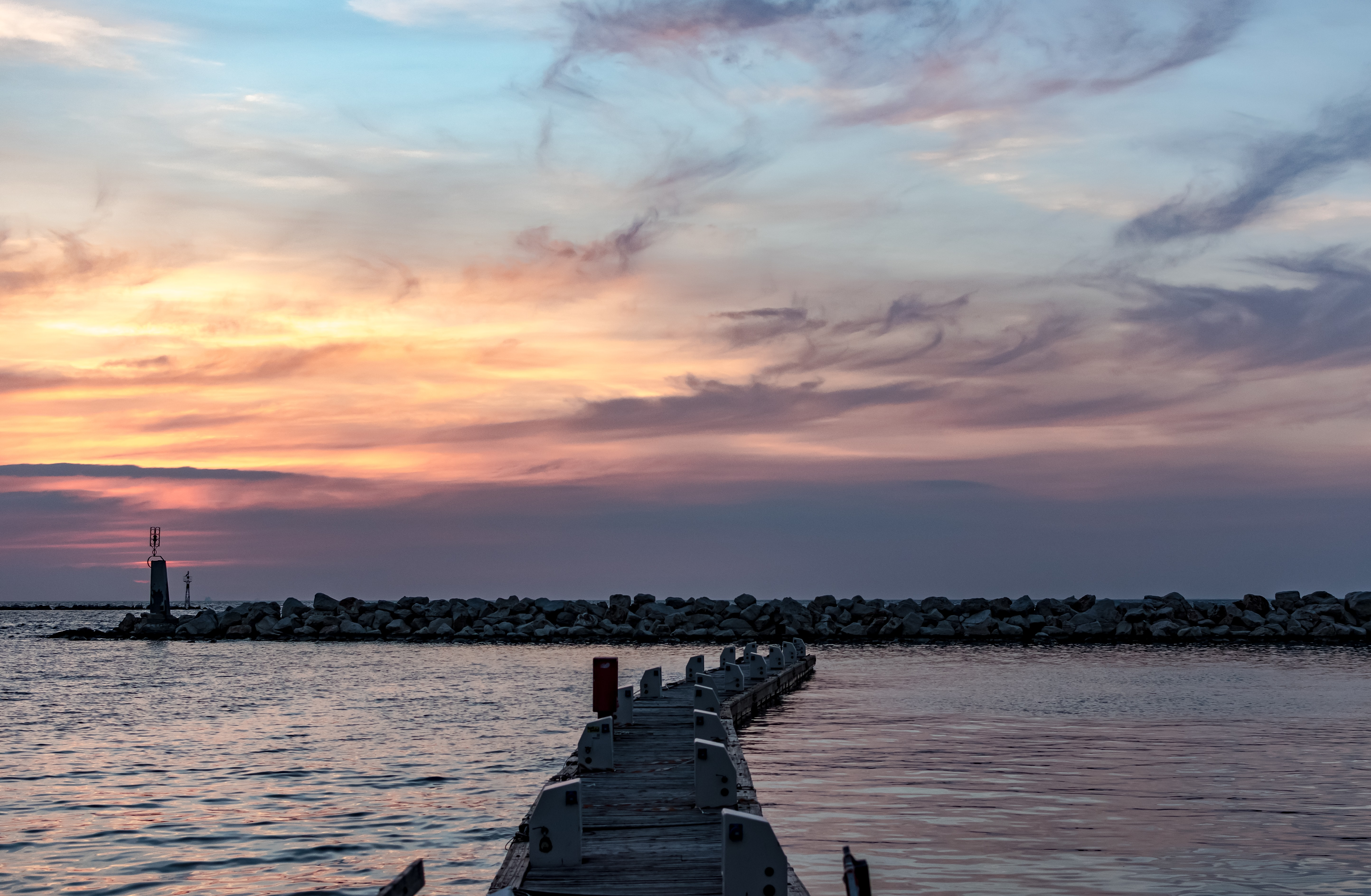 A jetty on the sea during sunrise or sunset in Patras