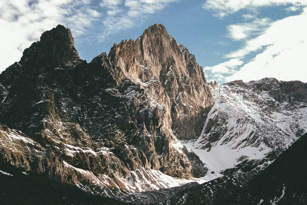 snow covered brown and gray mountain