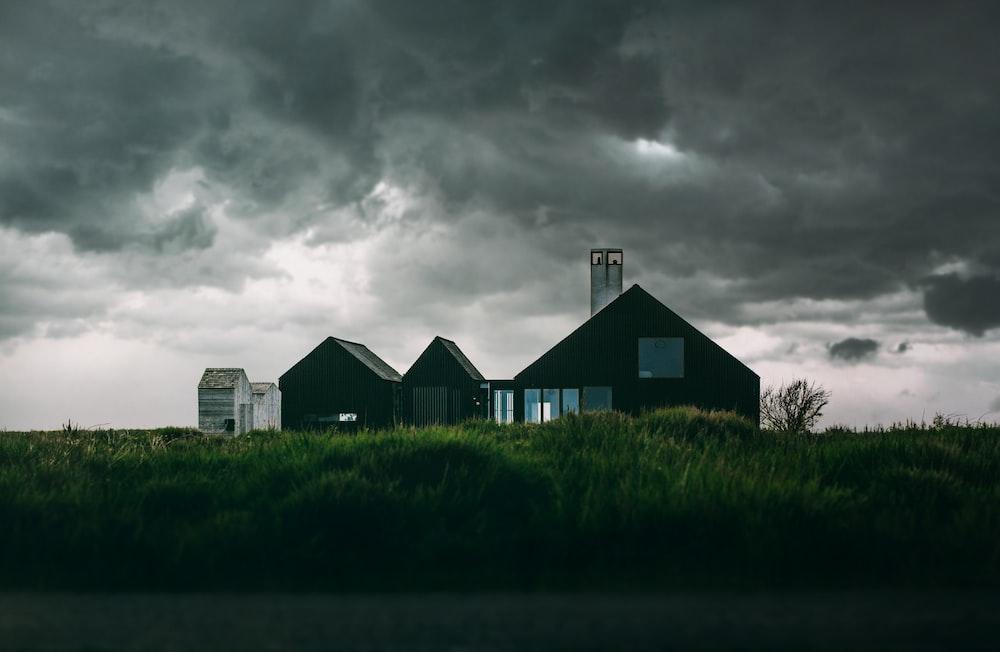 house underneath cumulus clouds