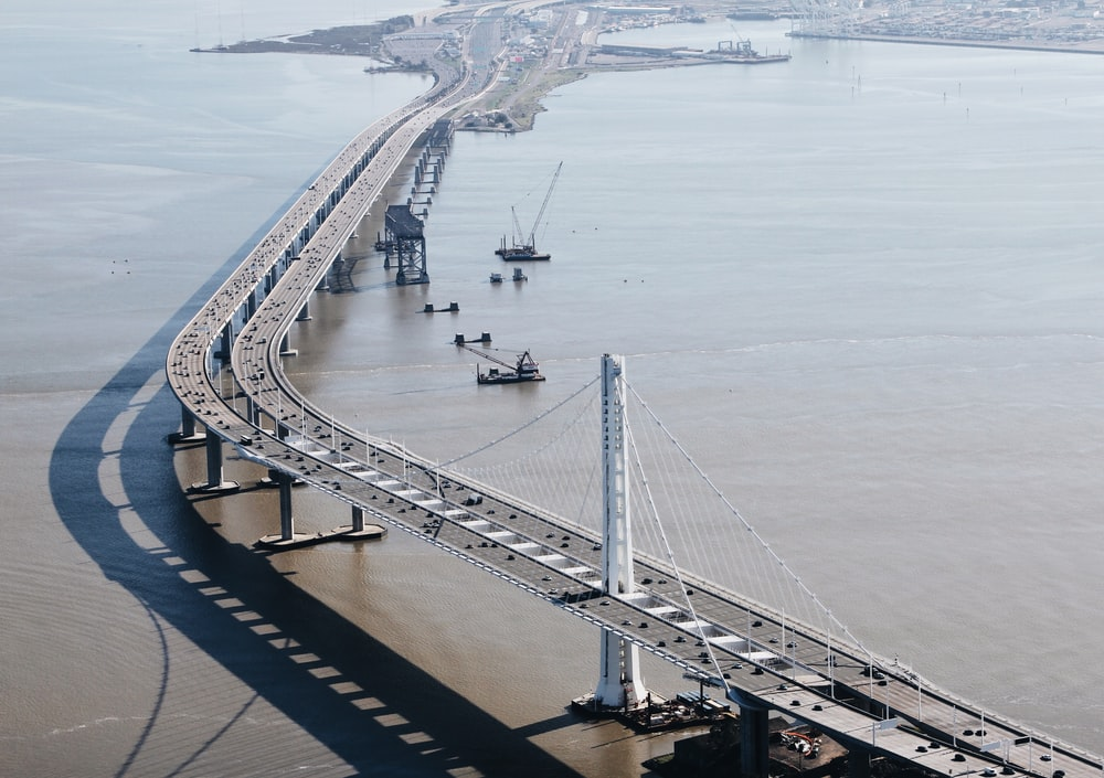 vehicles on suspension bridge at daytime