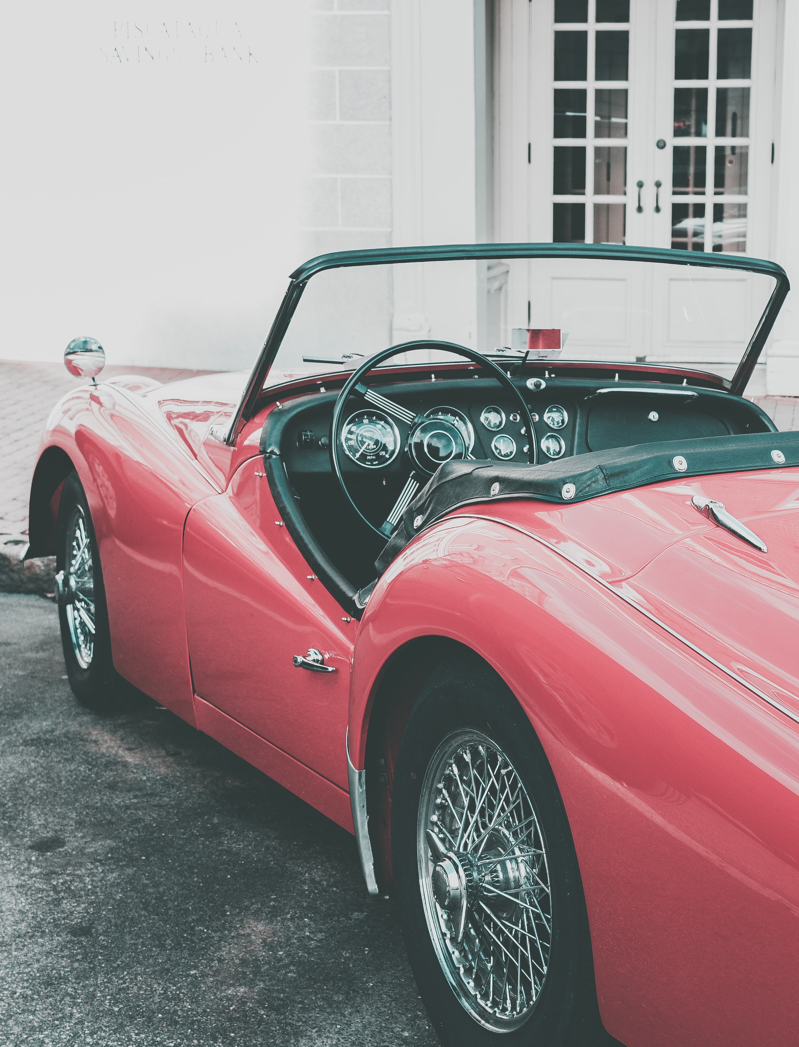 A red convertible parked outside.