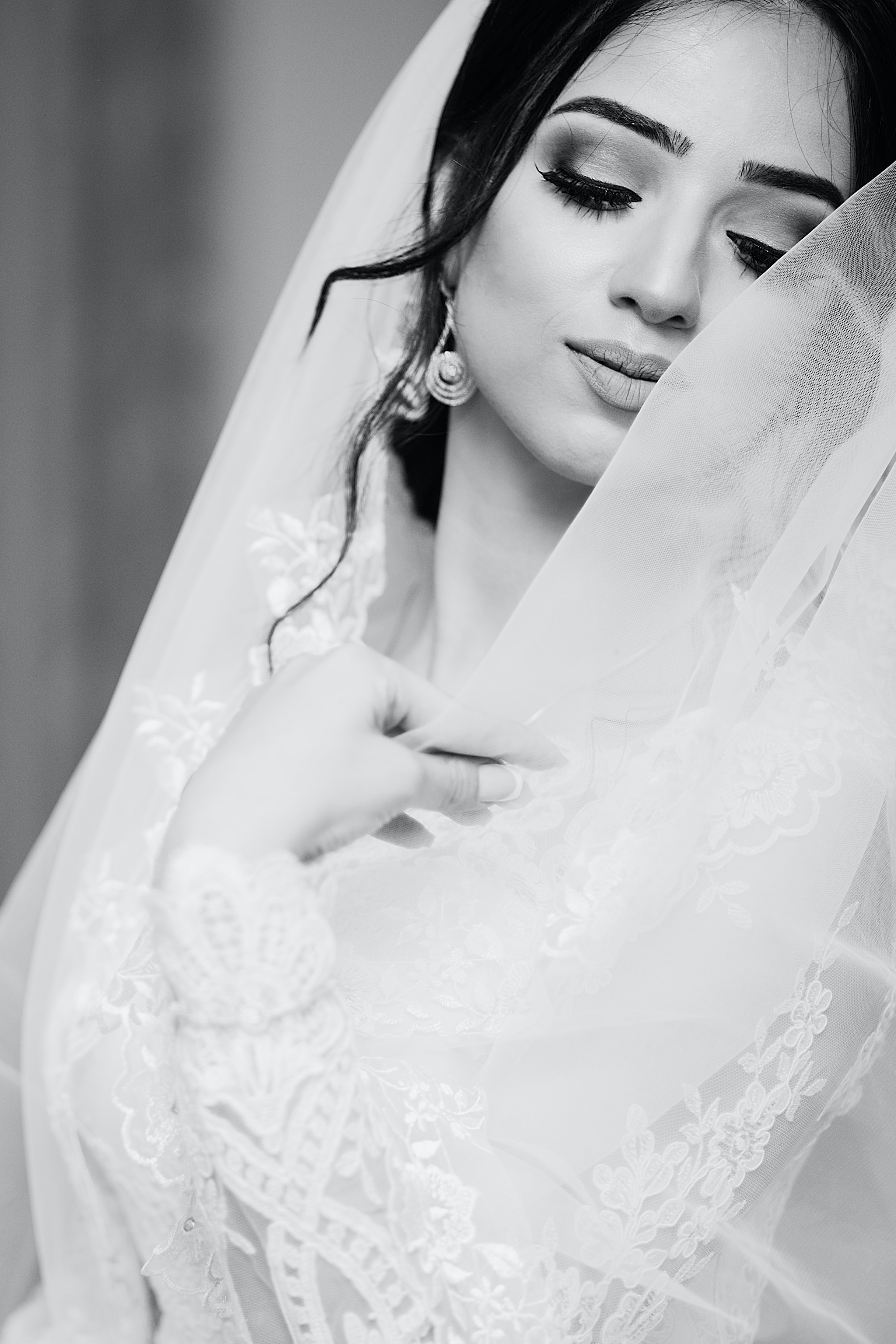 Black and white shot of bride with veil in wedding dress, New York, Texas, United States