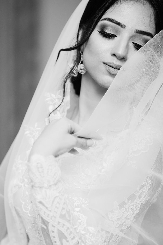 woman in white wedding dress closing eyes
