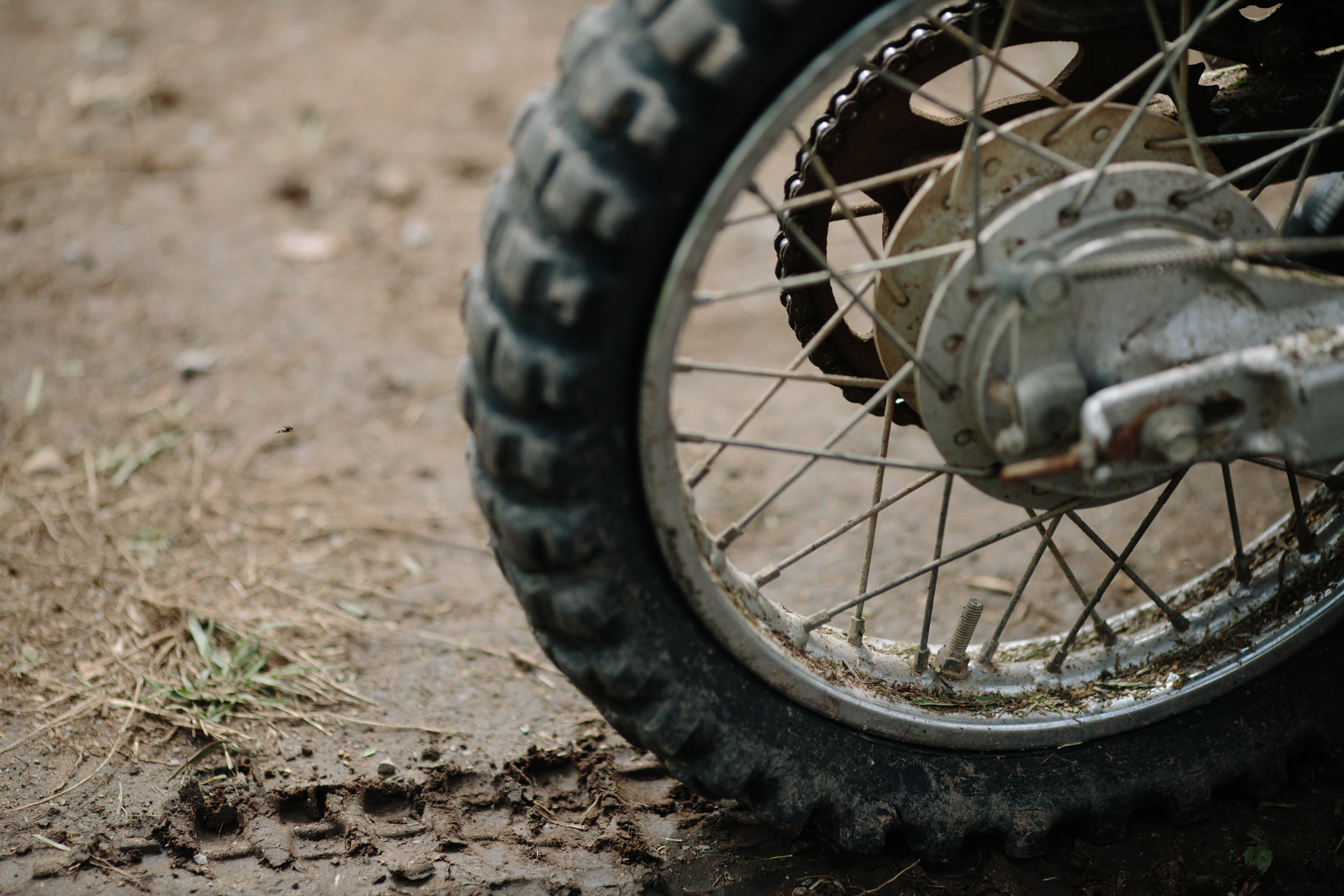 A close-up of a motorcycle tire and muddy track in Gresford.