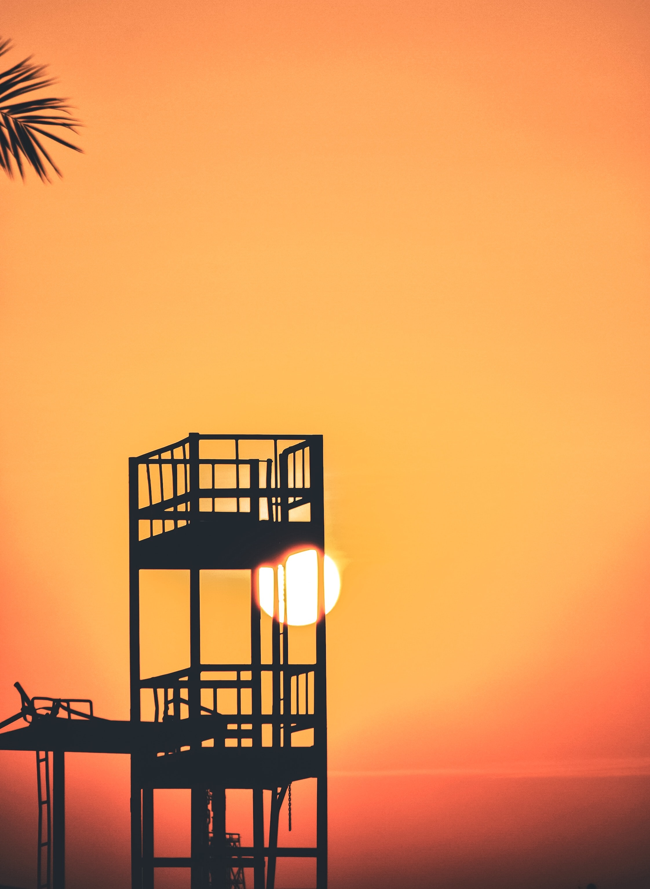 silhouette of watch tower during golden hour