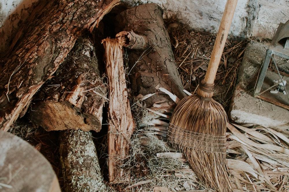 brown broom on brown fire logs