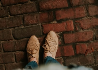 person standing on brick pavement
