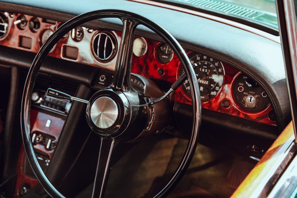 black and gray car steering wheel
