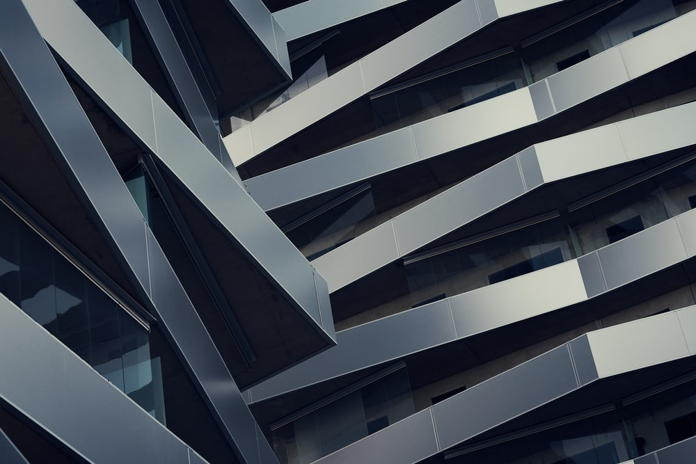 low angle photography of gray building at daytime
