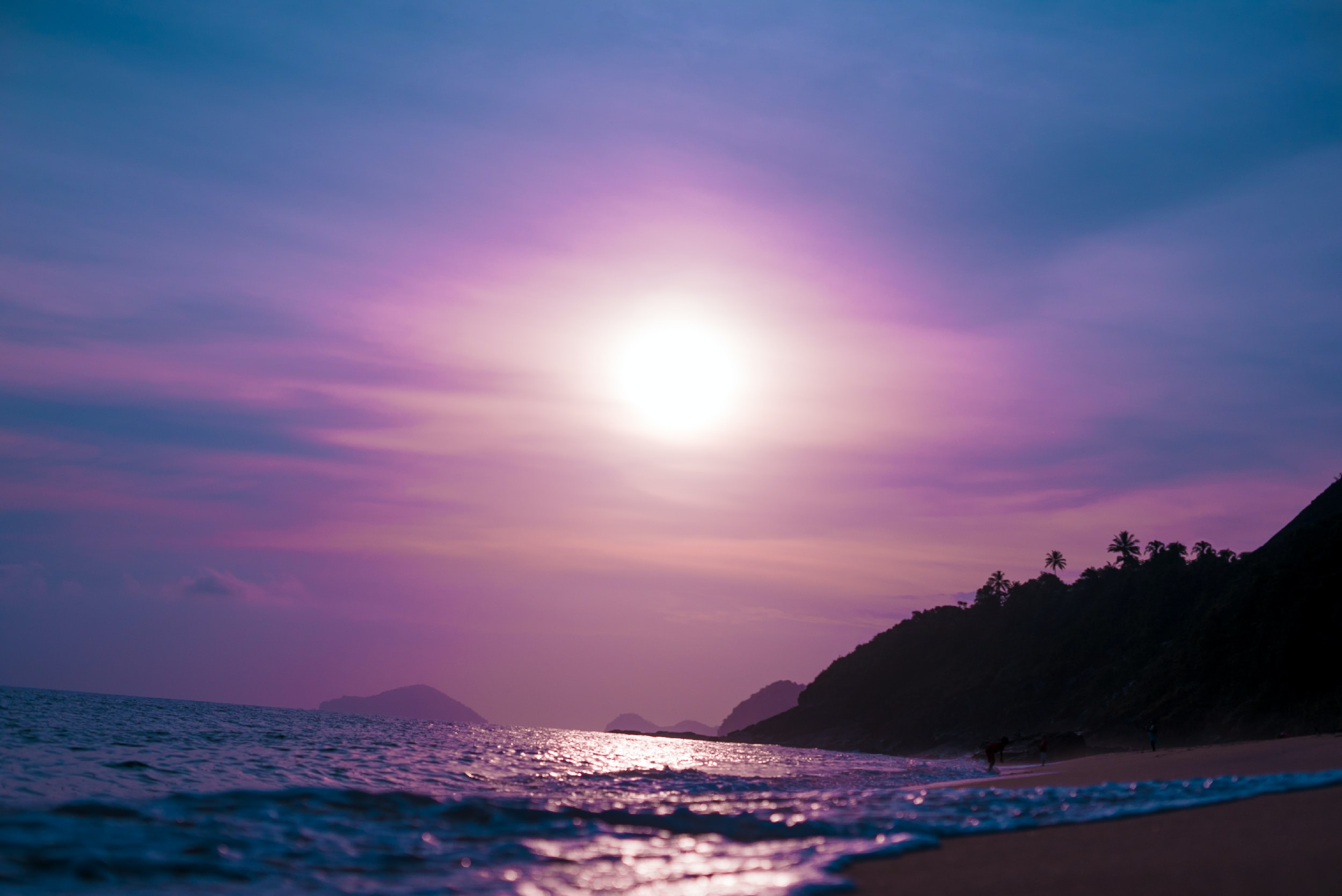 Purple view of the sun and sky from the sand beach in Natal