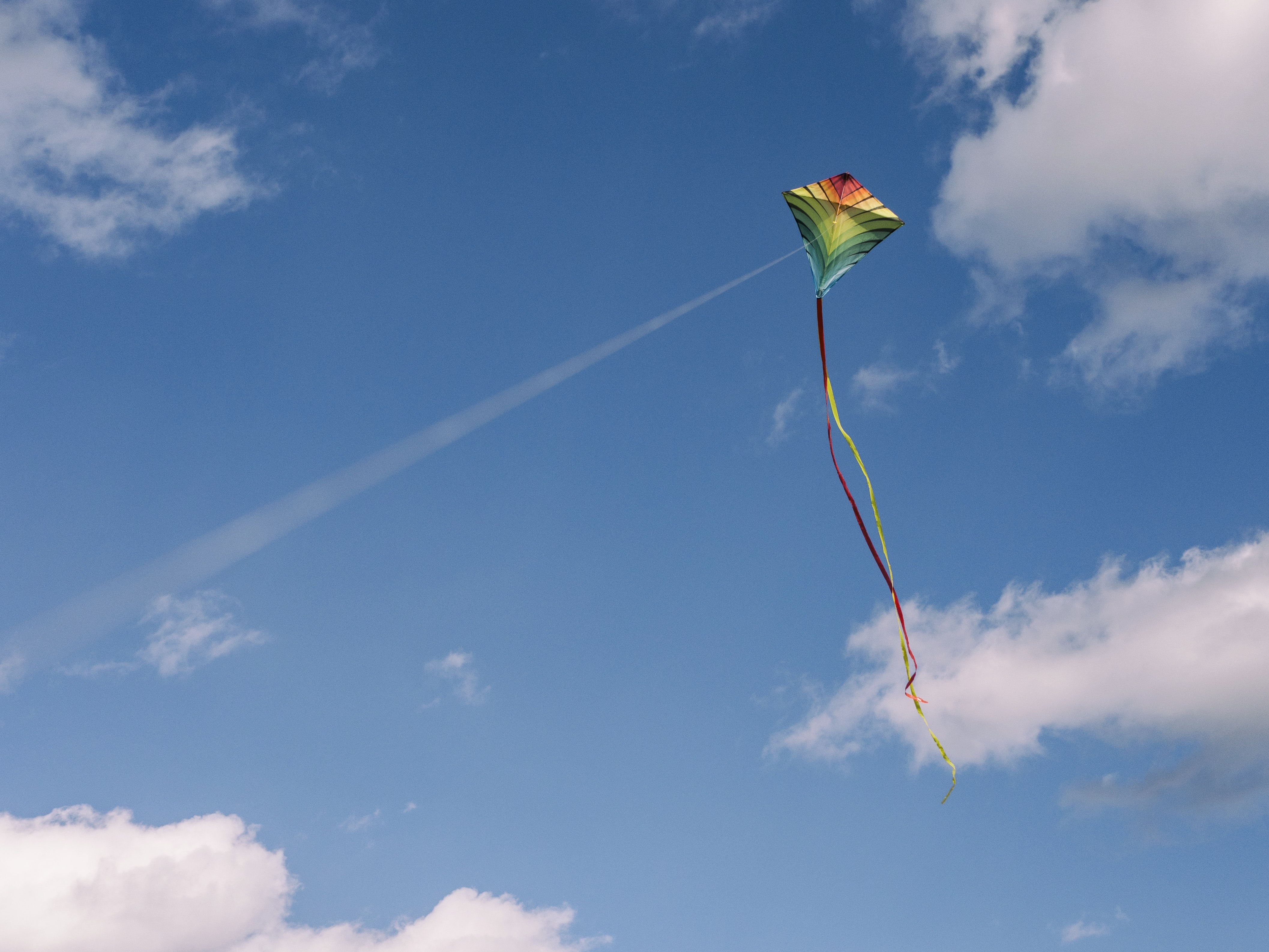 green and yellow kite on air