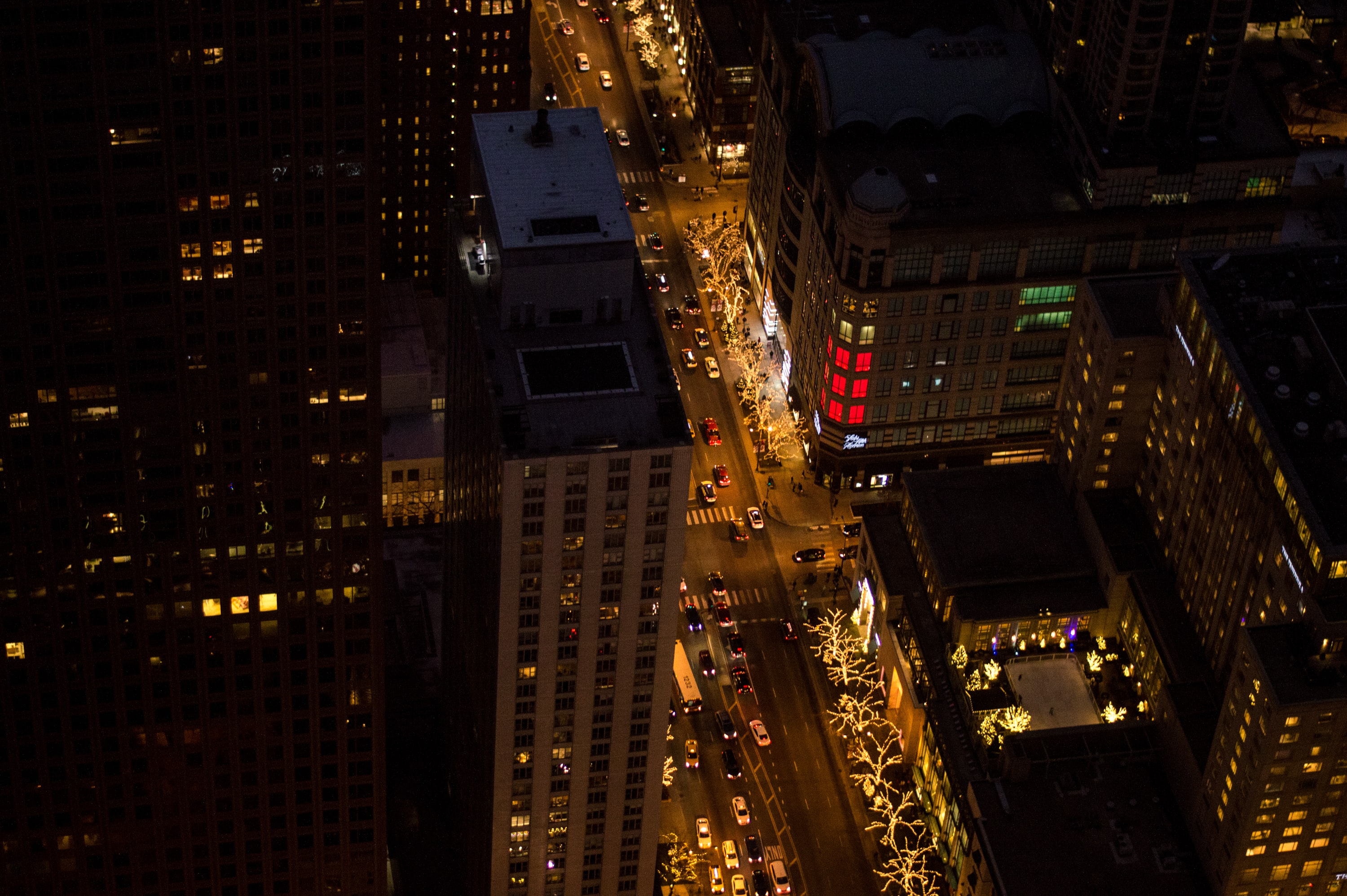 Aerial drone shot of busy city lit up at night