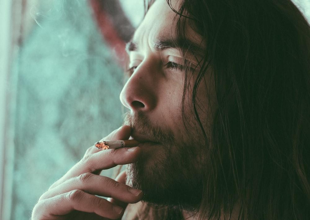 man smoking red cigarette