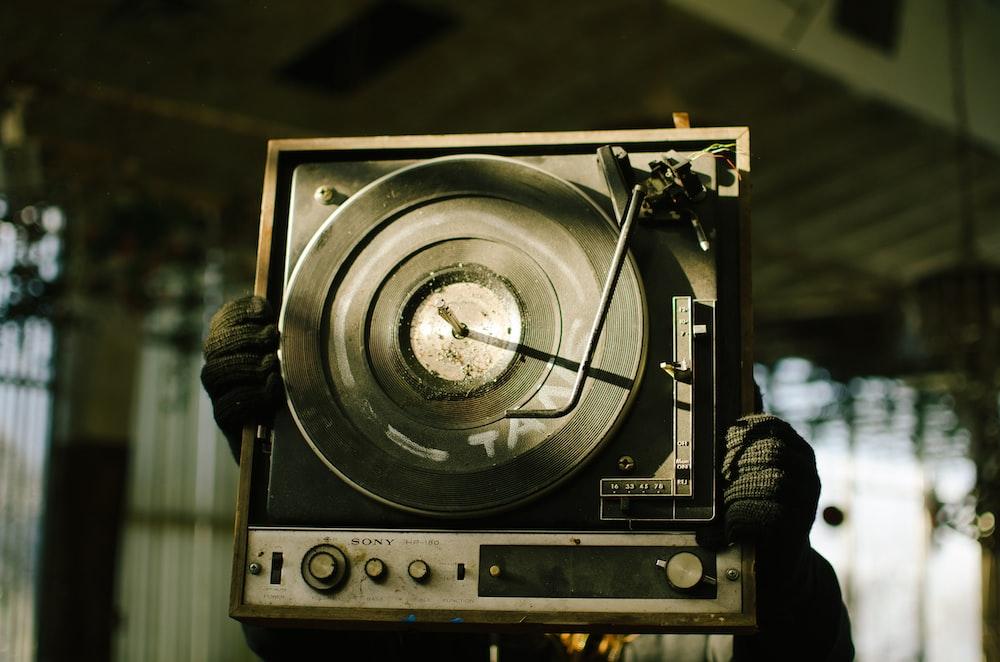 black and brown vinyl turntable