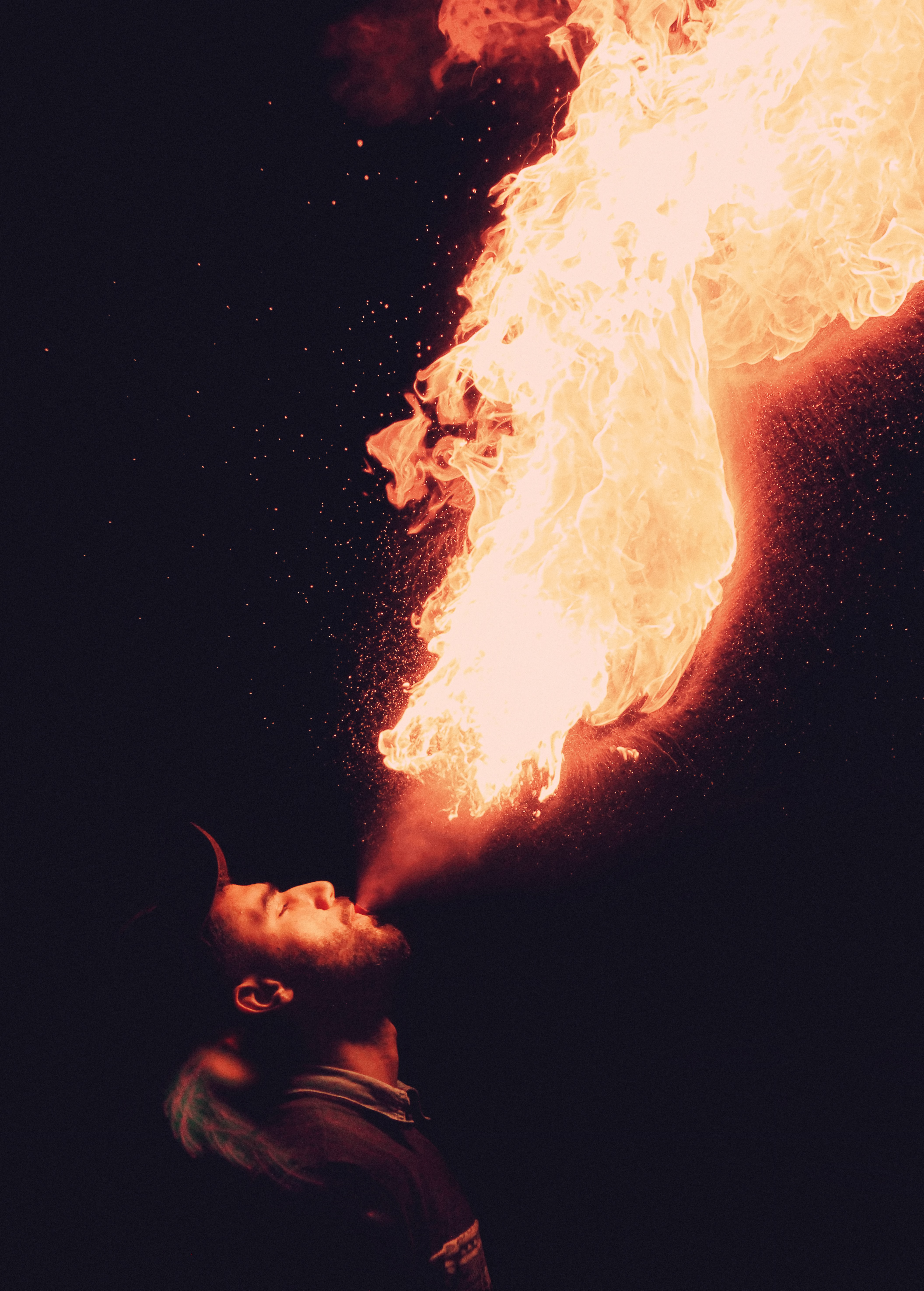 man blowing fire