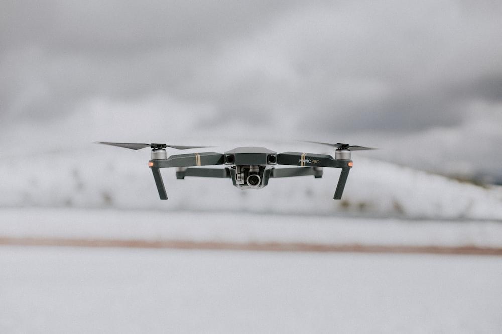 closeup photo of gray quadcopter