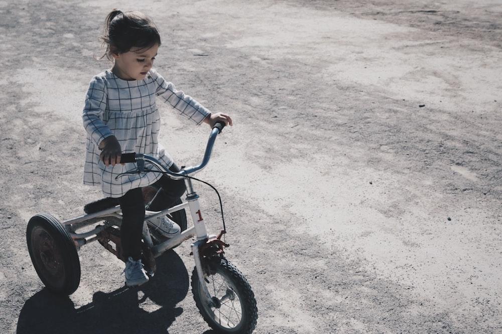girl riding trike
