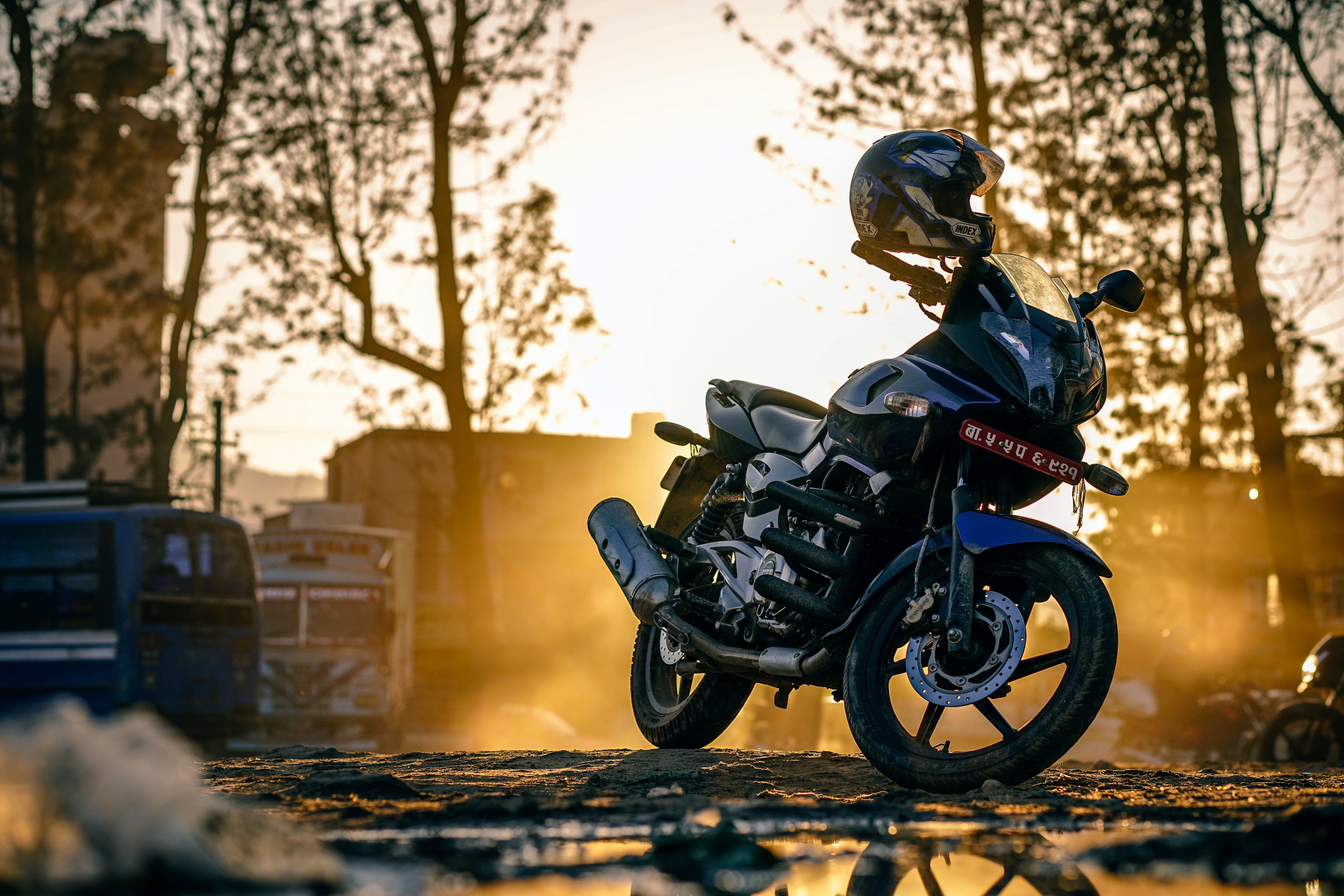 A motorcycle parked on a roadside in Kathmandu at sunset
