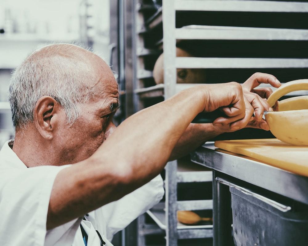 man beside bakery rack