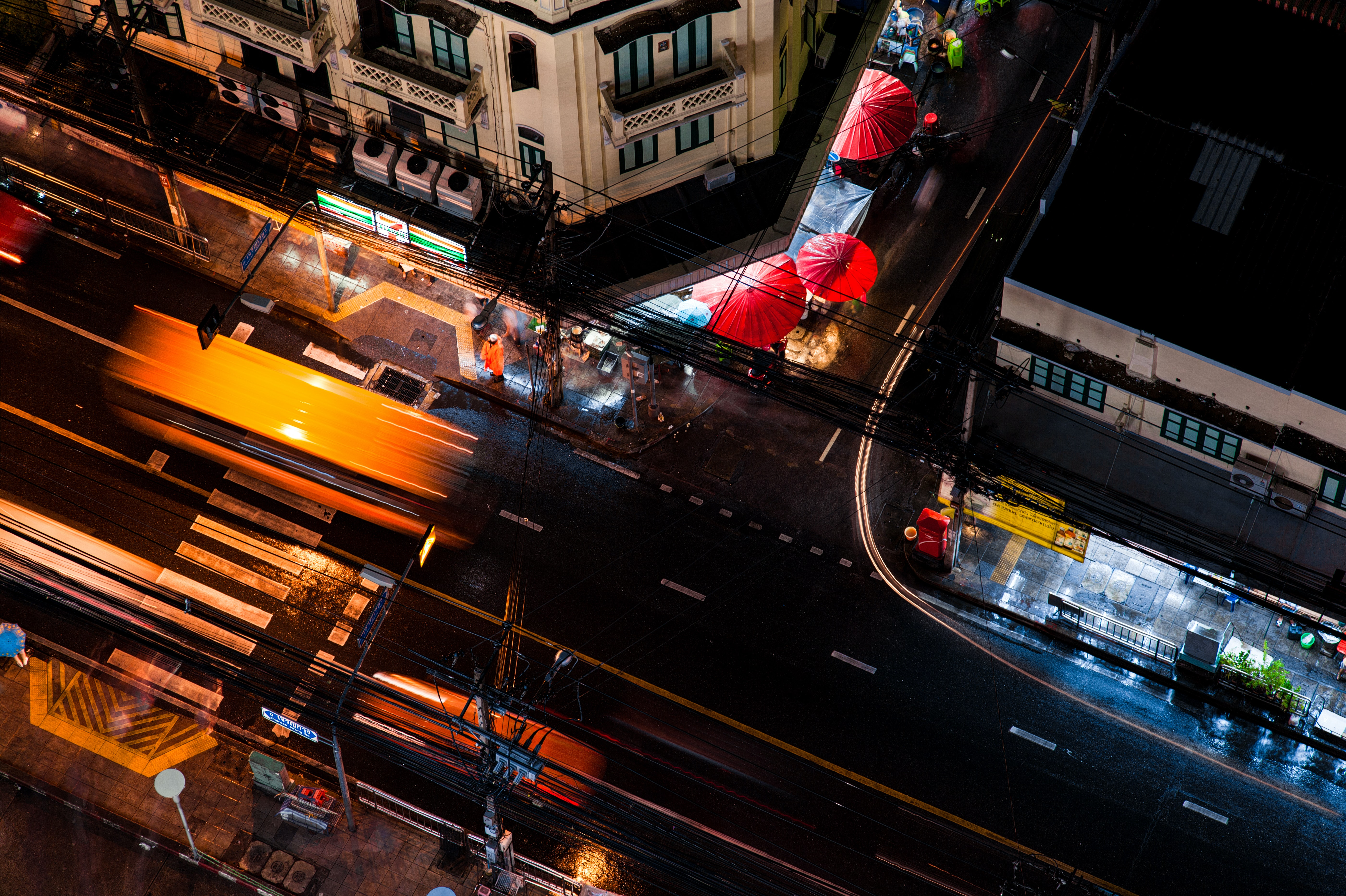 A bird's eye view taken by drone, showing the quiet night-time traffic on a road in Bangkok