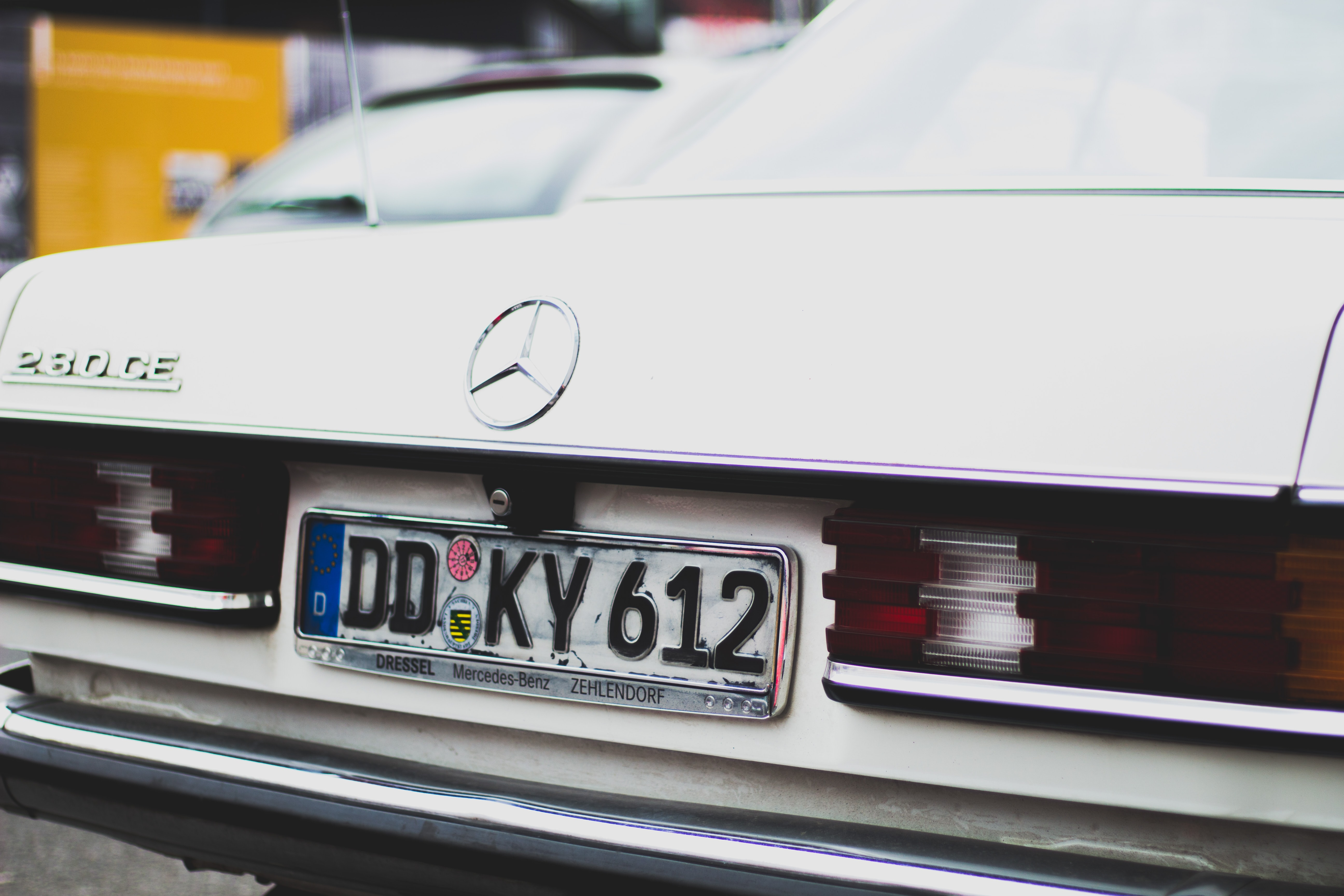 white Mercedez Benz car with license plate DD KY 612