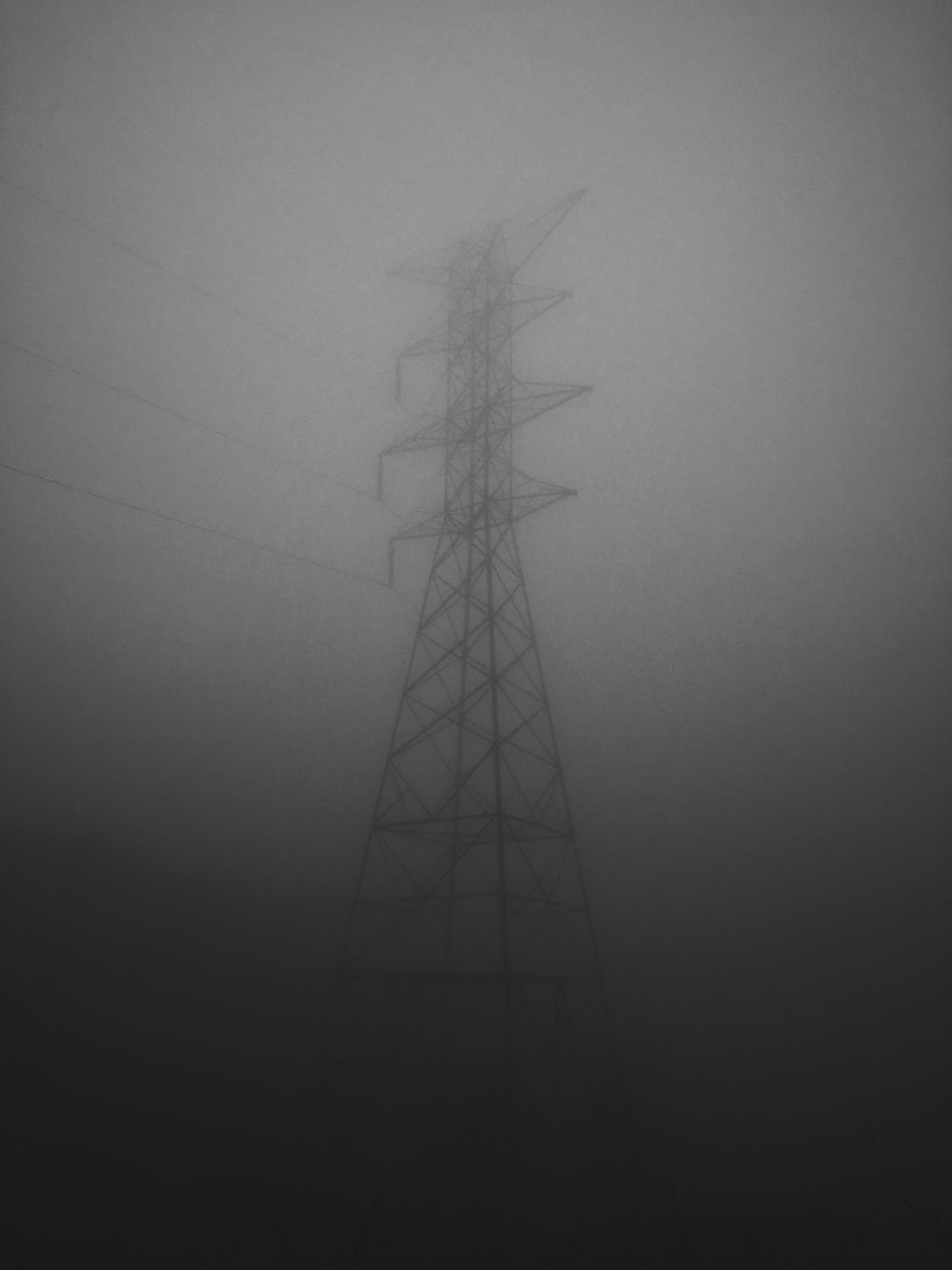 electric pylon covered by gray clouds