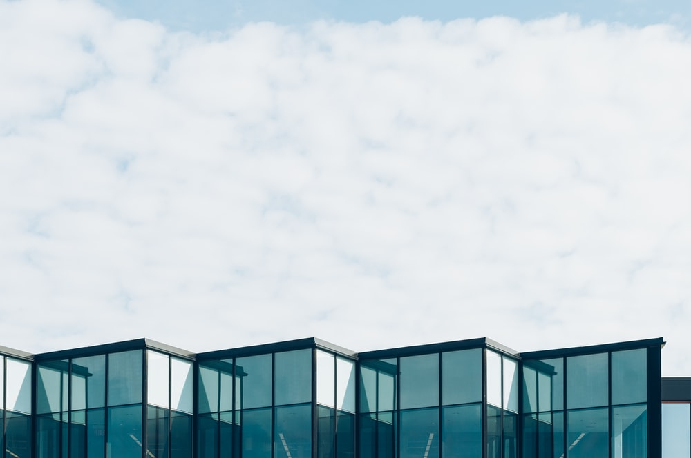 curtain wall building under cloud formation during daytime
