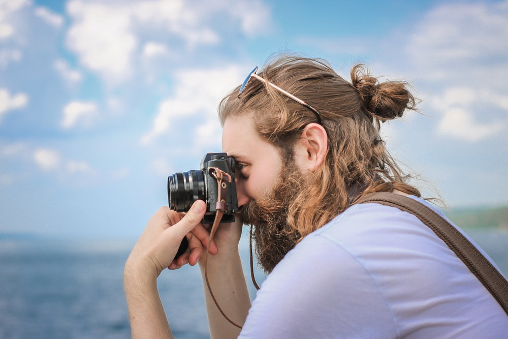 man taking a picture during daytime