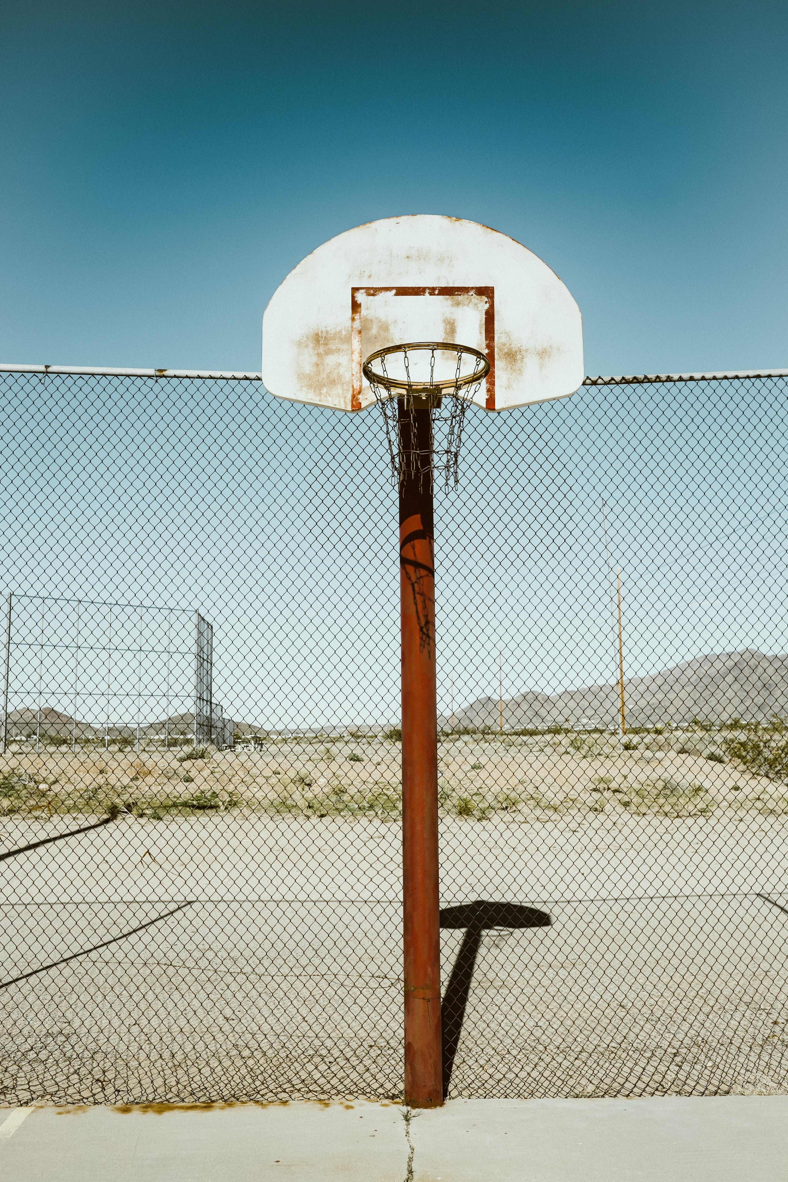 basketball hoop near fence