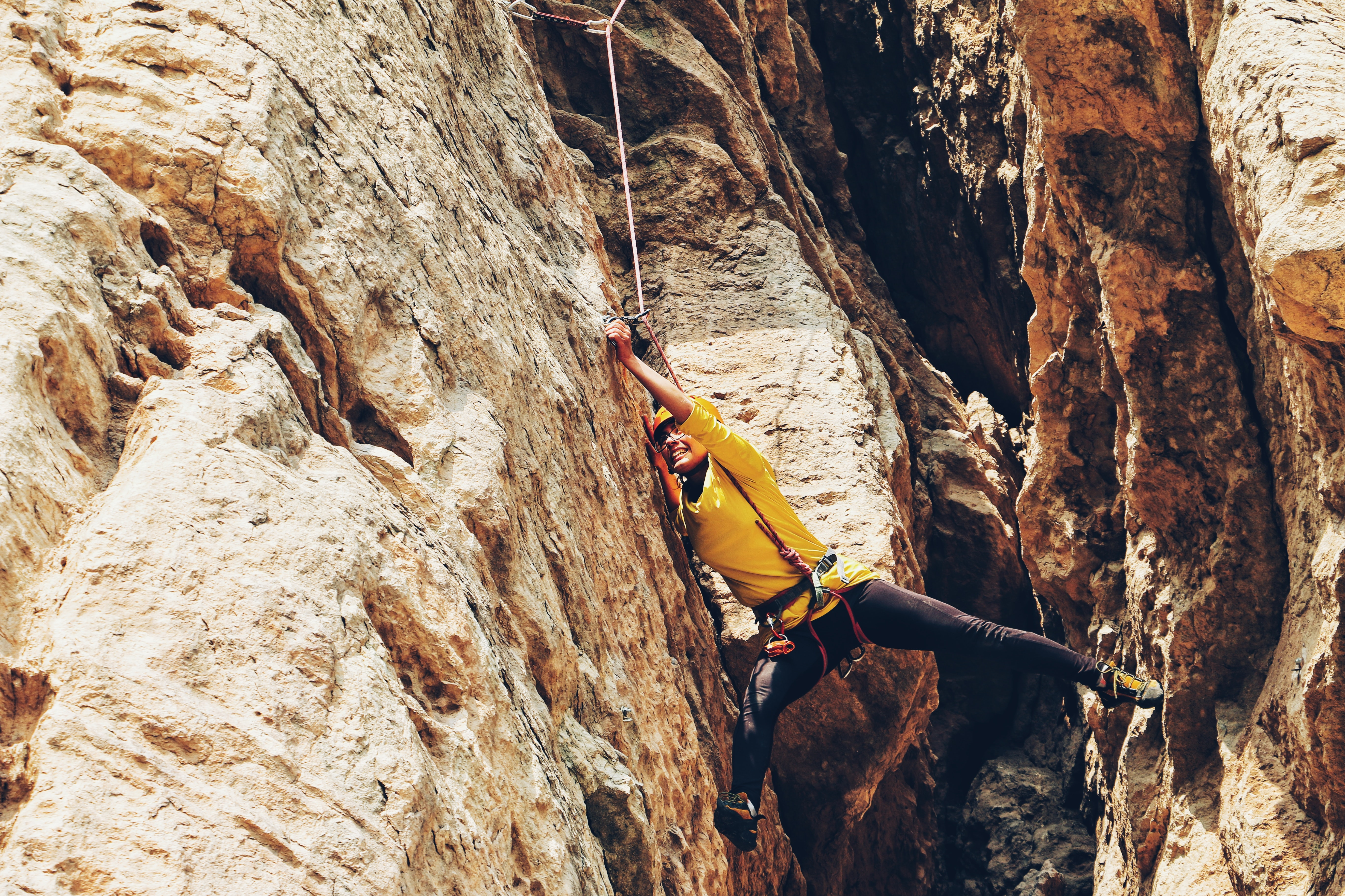 person climbing on the rock