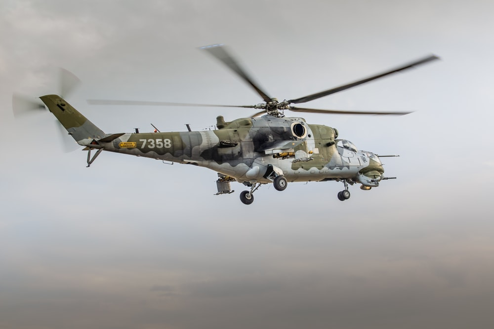 low angle photography of brown and gray helicopter