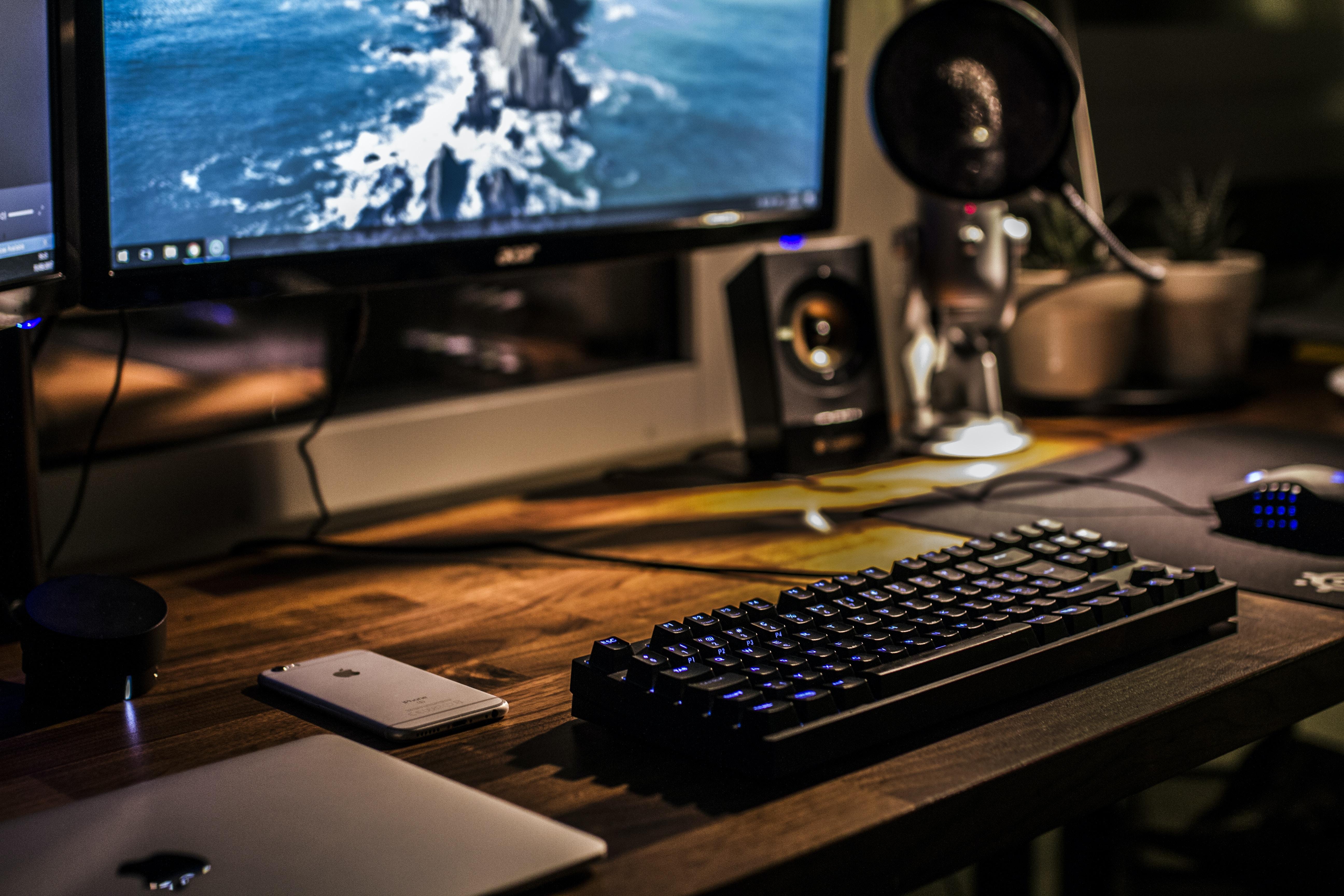black corded gaming computer keyboard and flat screen monitor