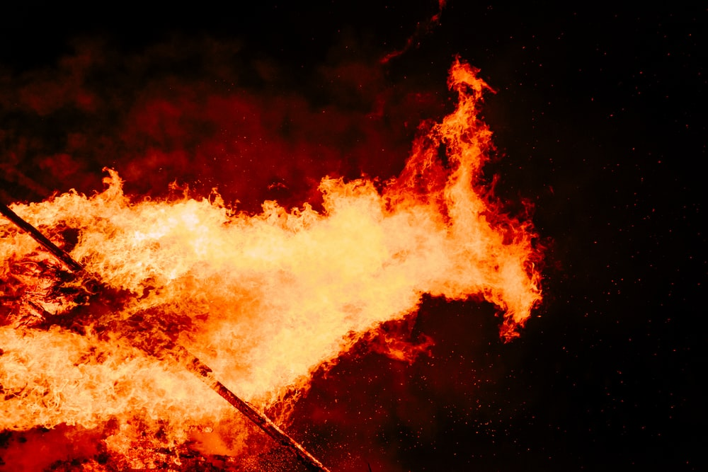 stick exposed in fire at nighttime