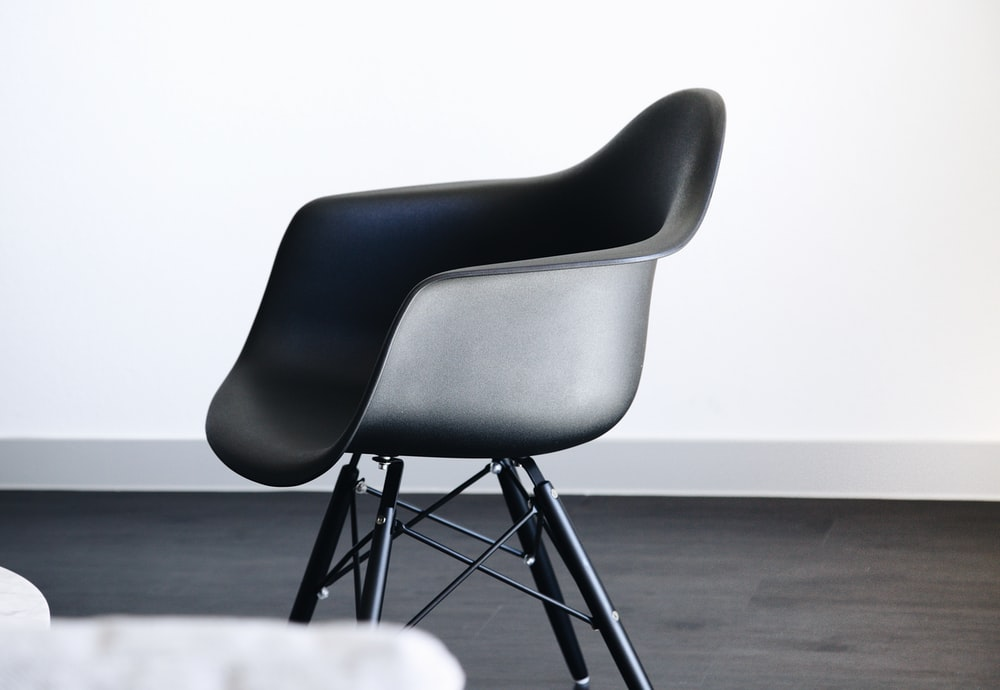 empty black plastic tub chair