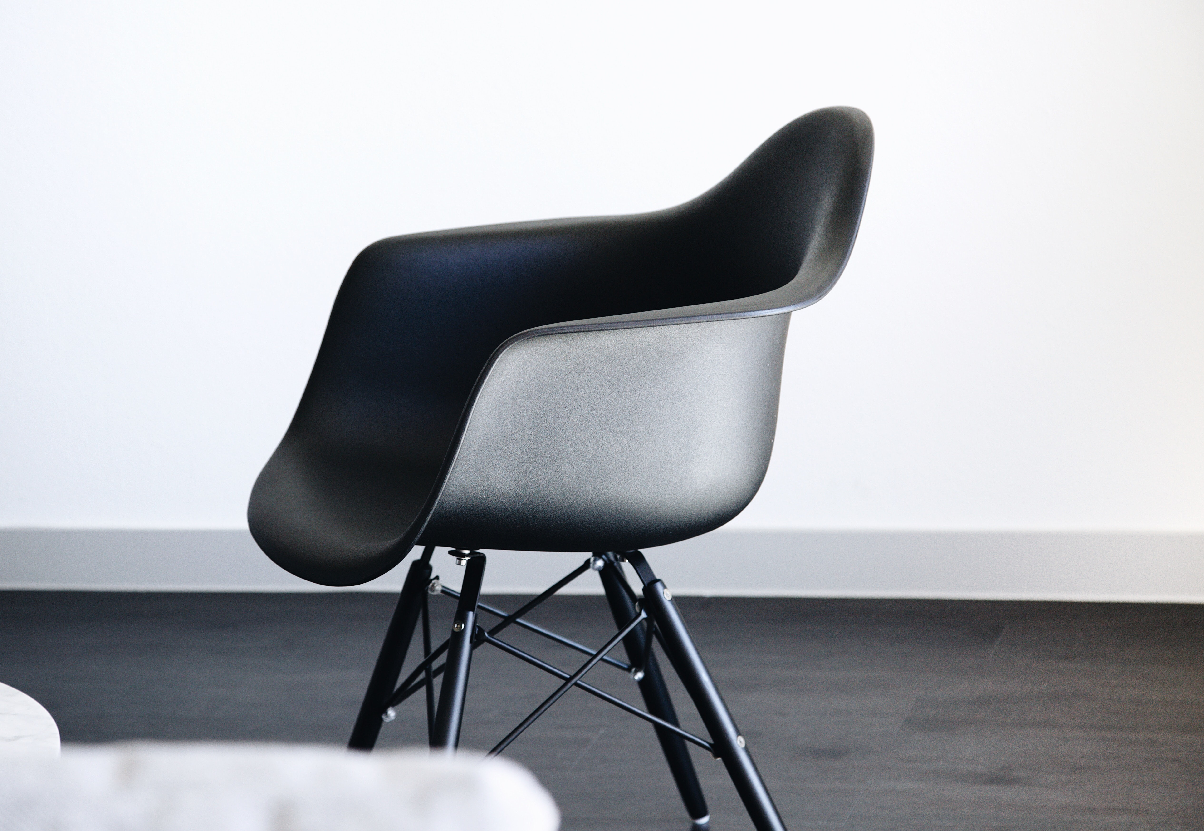 A small black plastic chair